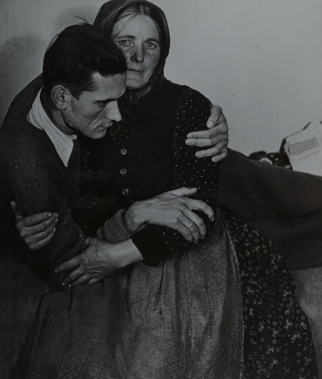 Madame d'Ora – Woman Support an Ailing Man, 1945, from the Refugees series, gelatin silver print, 34,7 x 29,5 cm.jpg